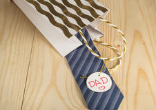 Father's day, gift, tie, dad tag on wooden background Stock Image