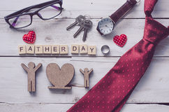 Father`s Day Gift and word `Father day`. On wooden floor - Ideas for Dad royalty free stock photo