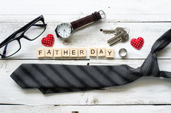 Father`s Day Gift and word `Father day`. On wooden floor - Ideas for Dad royalty free stock photos