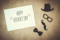 Fathers day greeting card. White card with decorative elements on craft paper background royalty free stock photos