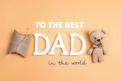 Father`s Day greeting message with toy bear and gift box on yell. Ow background. Happy fathers day concept stock photos