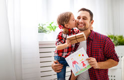 Free Father`s Day. Happy Family Daughter Giving Dad Greeting Card Stock Photography - 91501922