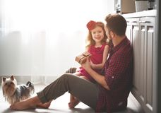 Father`s day. Happy family daughter giving dad greeting card Royalty Free Stock Photos