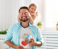 Father`s day. Happy family daughter hugging dad and laughs. On holiday stock images