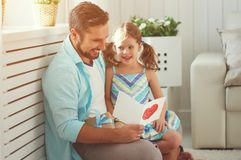 Father`s day. Happy family daughter hugging dad and laughs Stock Images