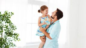 Father`s day. Happy family daughter hugging dad and laughs Royalty Free Stock Photo