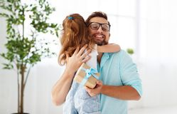 Father`s day. Happy family daughter hugging dad and laughs Royalty Free Stock Photos