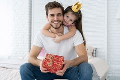 Father`s day. Happy family daughter hugging dad and laughs on holiday. royalty free stock photo