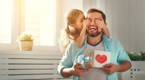 Father`s day. Happy family daughter hugging dad and laughs. On holiday stock photo