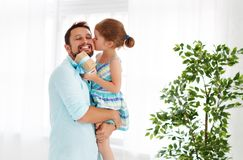 Father`s day. Happy family daughter hugging dad and laughs Royalty Free Stock Images