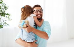Father`s day. Happy family daughter hugging dad and laughs Royalty Free Stock Photography
