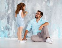 Father`s day. Happy family daughter hugging dad and laughs near Royalty Free Stock Photography