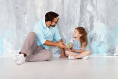 Father`s day. Happy family daughter hugging dad and laughs near Royalty Free Stock Images