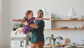 Father`s day. Happy family daughter hugs his dad. On holiday stock image