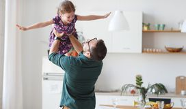 Father`s day. Happy family daughter hugs his dad Stock Image