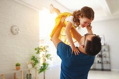 Father`s day. Happy family daughter hugs his dad. On holiday stock photos