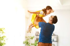 Father`s day. Happy family daughter hugs his dad. On holiday royalty free stock images