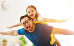 Father`s day. Happy family daughter hugs his dad. On holiday stock photo