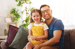 Father`s day. Happy family daughter hugs his dad. On holiday royalty free stock photos