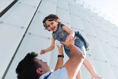 Father`s day. Happy family daughter hugs his dad on holiday. Father`s day concept. Father throwing his little daughter in the air. Happy and joyfull child stock photography