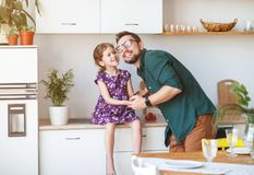 Father`s day. Happy family daughter hugs his dad Stock Photos