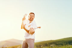 Father`s day. Happy family father and toddler son playing and la. Ughing on nature at sunset Stock Image