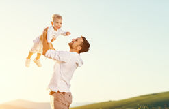 Father`s day. Happy family father and toddler son playing and la. Ughing on nature at sunset stock images