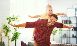 Father`s day. Happy family son hugs his dad. On holiday royalty free stock photo