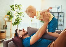 Father`s day. Happy family son hugs his dad stock photography