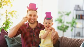 Father`s day. Happy funny family son and dad with hat stock image