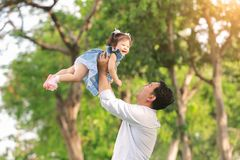 Father`s day. Happy joyful father having fun throws up in the ai. R child stock image