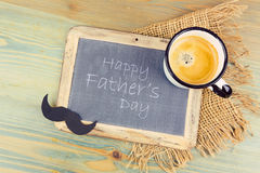 Father's day holiday background with chalkboard and coffee cup. Stock Photo