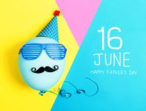 Father`s Day message with party balloon. With hat and glasses royalty free stock image
