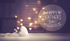 Father`s Day message with a white heart. With heart shaped lights stock photo