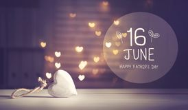 Father`s Day message with a white heart. With heart shaped lights stock image