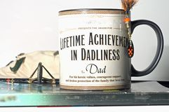 Father's day mug present dad. These are the types of presents you can get for dad a Brown and black father's day celebration Lifetime Achievement for best dad royalty free stock images