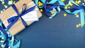 Father`s Day overhead with decorated borders on dark blue wood table. Happy Father`s Day overhead with decorated borders, gift and greeting card on dark blue stock images