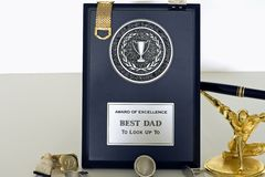Father's Day Plaque for dad. Display of things to get dad for a father's day gift like a Silver and black father's day celebration plaque for holiday for best stock photos