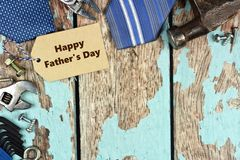 Father's Day tag and border of tools on blue wood Stock Photography