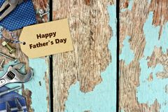 Father's Day tag and border of tools on blue wood Stock Image