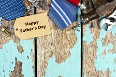 Father's Day tag and top border of tools on wood Stock Photos