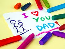 Father`s day theme with I LOVE YOU DADD message. Kid drawing of father holding his child for happy father`s day theme with I LOVE YOU DADD message Stock Photography
