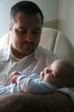 Father's lullaby. Father lulling his baby gently Royalty Free Stock Photo