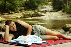 Father's relax. Father and son relaxing on a river bank Stock Image