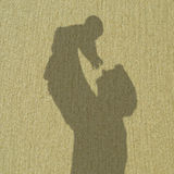 Father's shadow holds baby Royalty Free Stock Photography