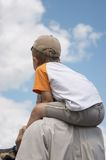 On father's shoulders. The little boy sits on shoulders of the father. It is photographed on aviashow Royalty Free Stock Photography
