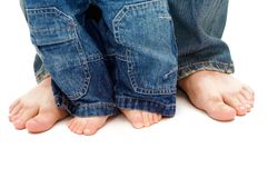 Father's and son's feet. On white background Royalty Free Stock Images