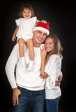 Father in santa hat Stock Image