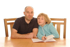 Father and daughter with homework Stock Photography