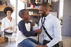 Father Saying Goodbye To Son As He Leaves For Work royalty free stock image